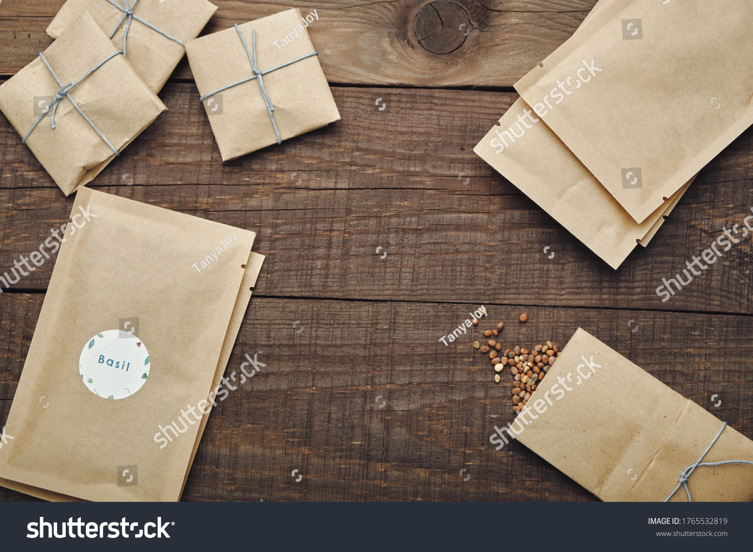 Paper bags with seeds for planting. Wooden table. View from above. #1765532819