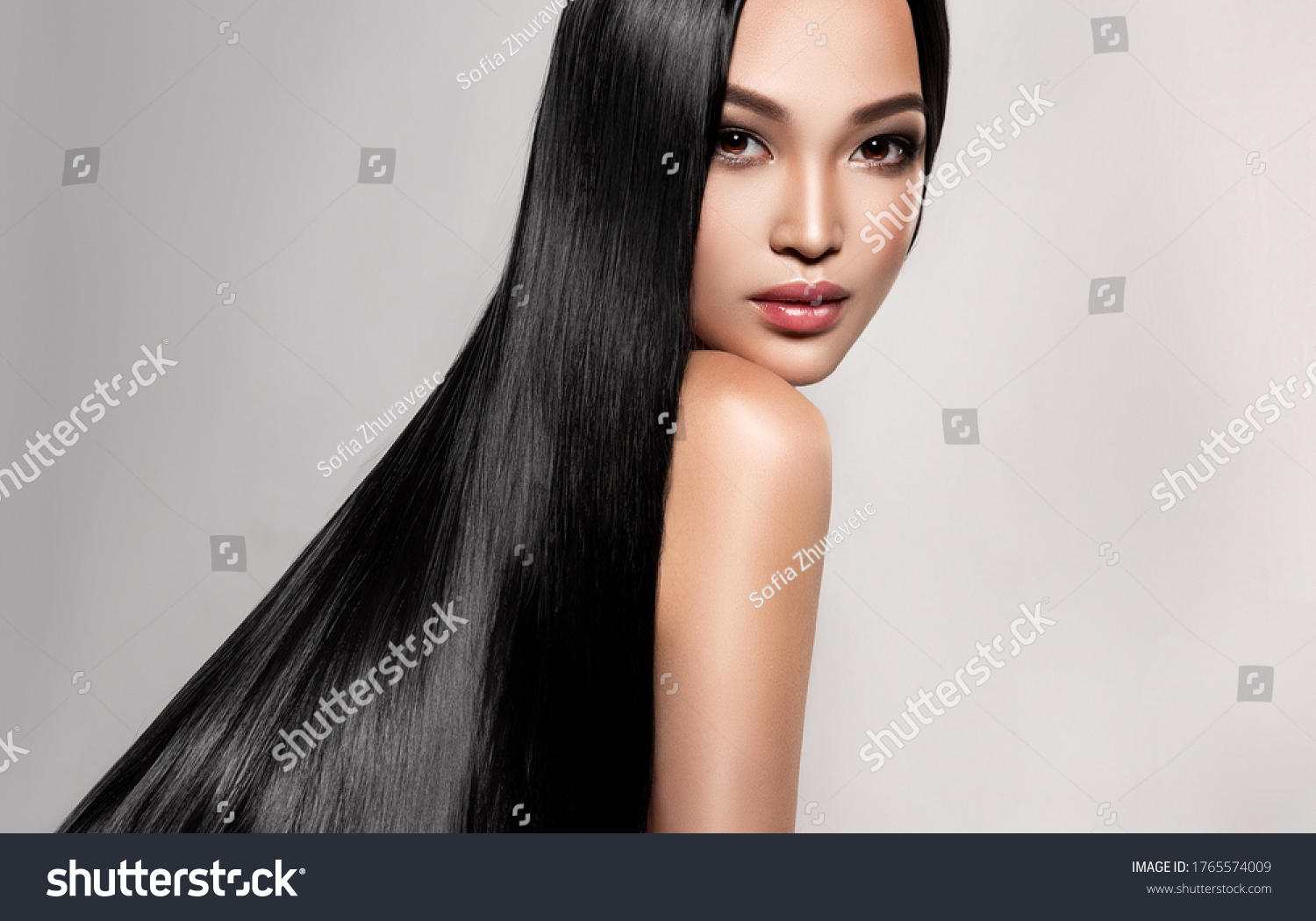 Beautiful asian model girl with shiny black and straight long hair . Keratin straightening . Treatment, care and spa procedures for hair . Chinese girl with smooth hairstyle #1765574009