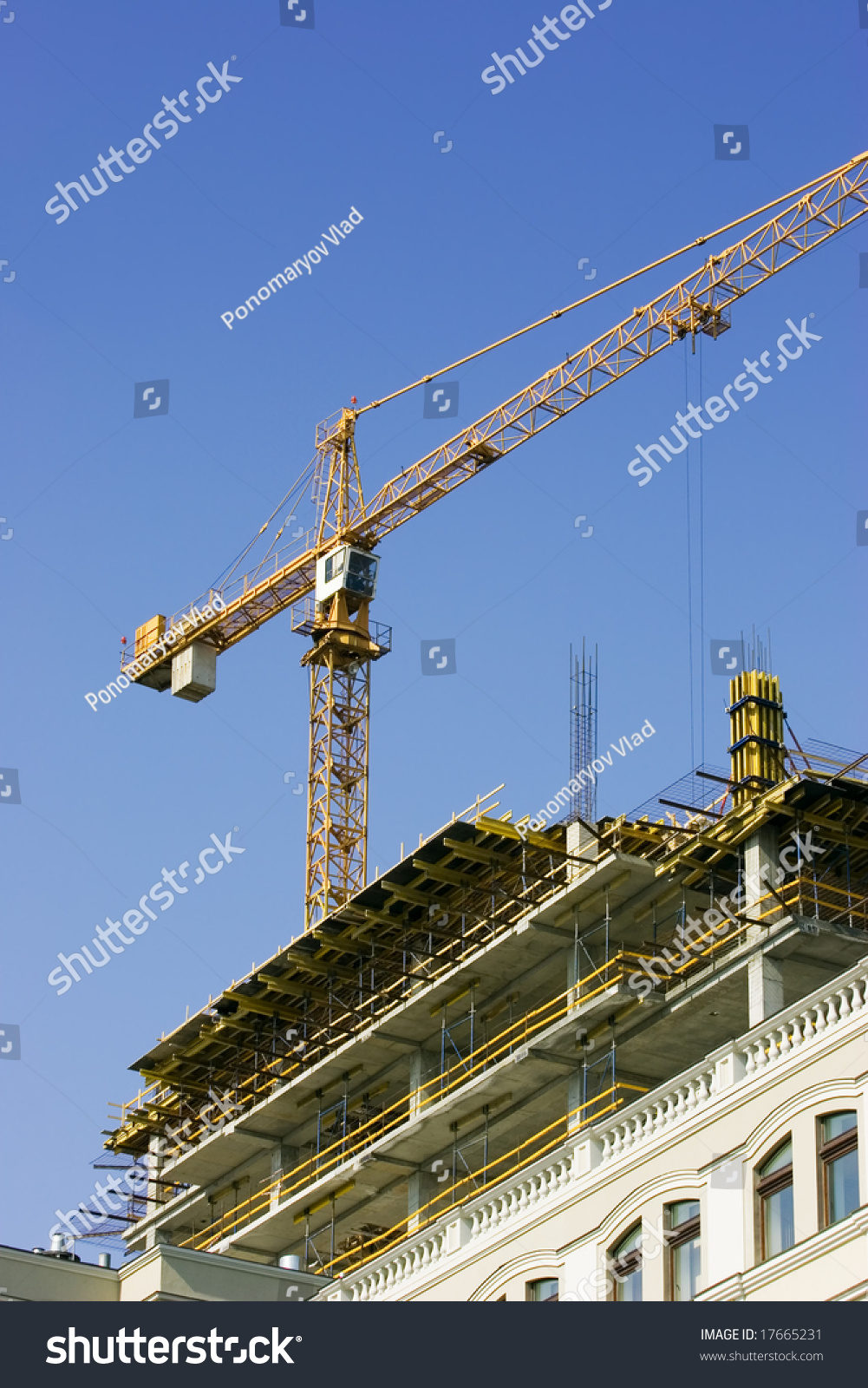crane and highrise building stock photo 17665231