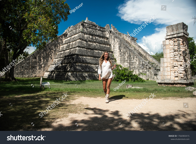 Pregnant woman in Chichen Itza. Mayan pyramid in Yucatan, Mexico. Travel concept.