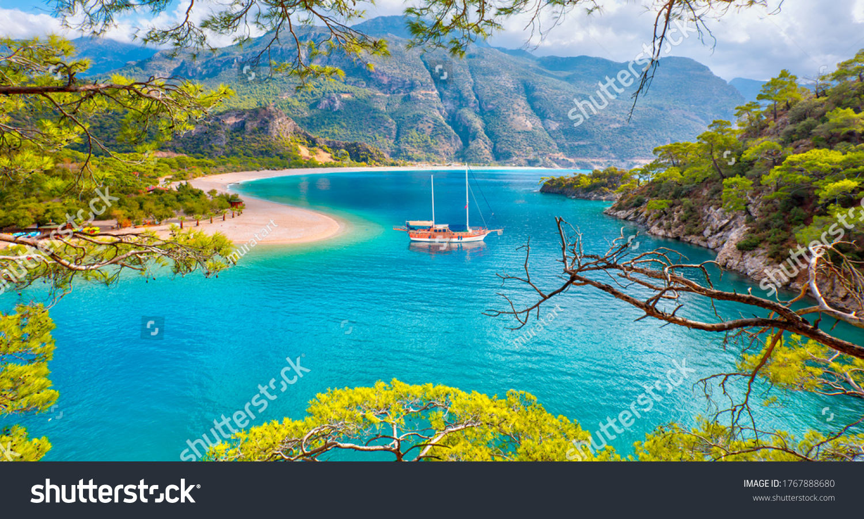 Brown gulet anchored at the Aegean sea - Panoramic view of Oludeniz Beach And Blue Lagoon, Oludeniz beach is best beaches in Turkey - Fethiye, Turkey #1767888680