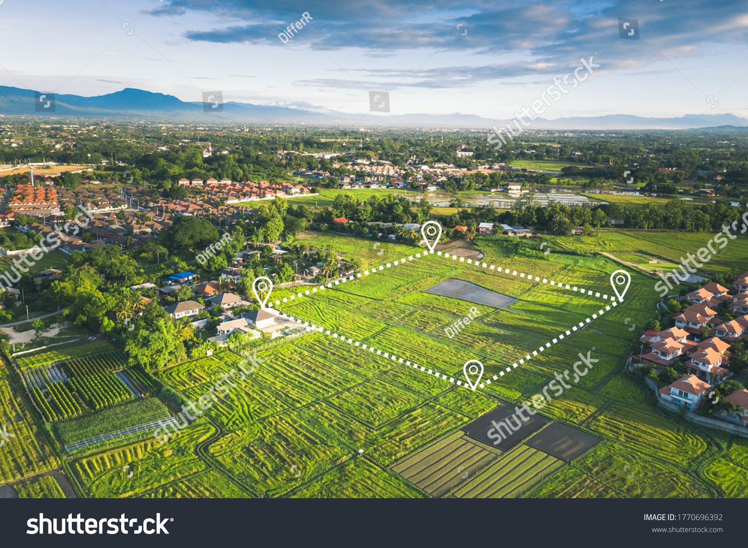 Land plot in aerial view. Include landscape, real estate, green field, agricultural plant, pin location icon. For housing subdivision, residential, development, owned, sale, rent, buy or investment. #1770696392