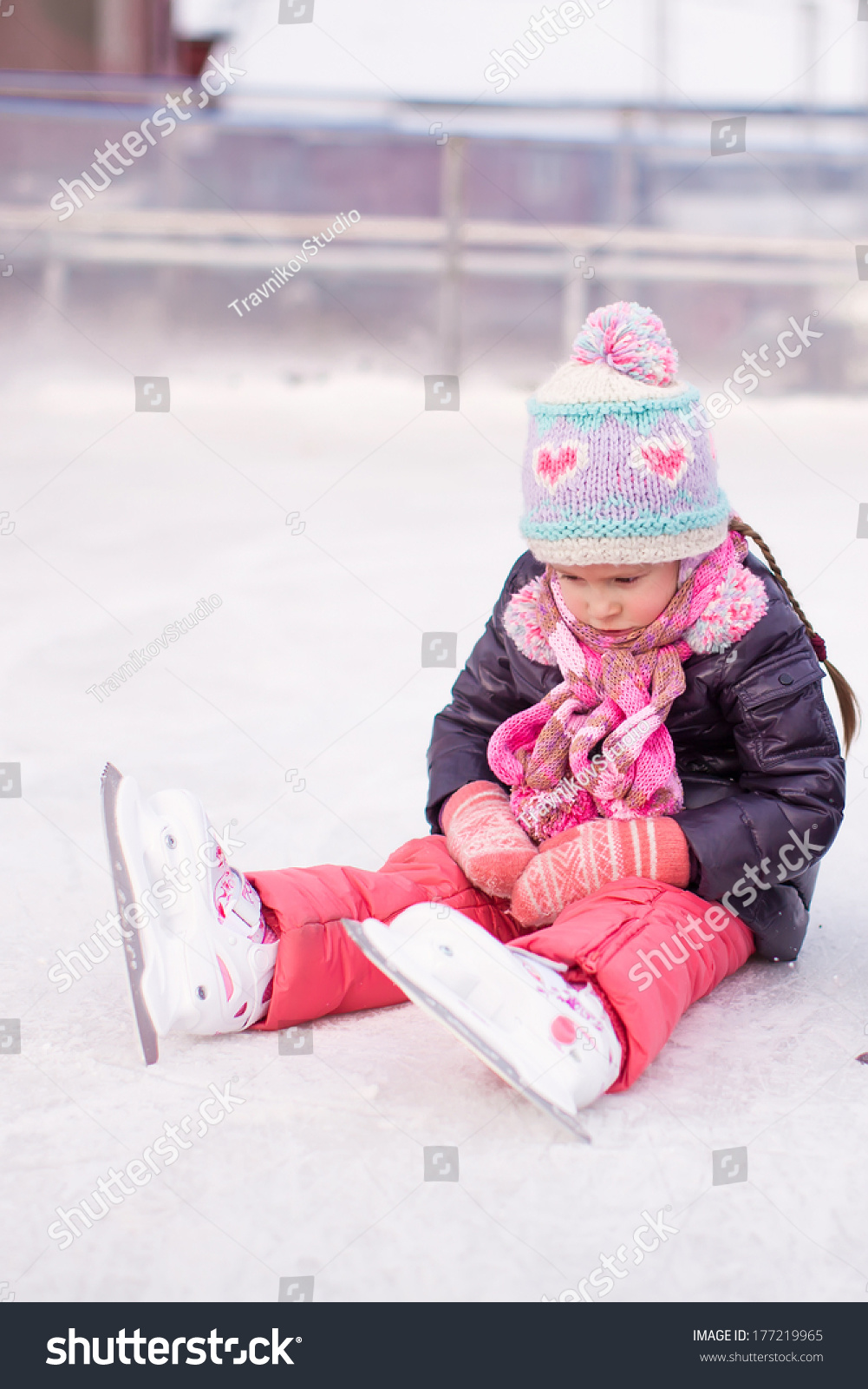 Sad Girl Sitting Alone Outside Stock Photos Sad Girl: Little Sad Girl Sitting On A Skating Rink After The Fall