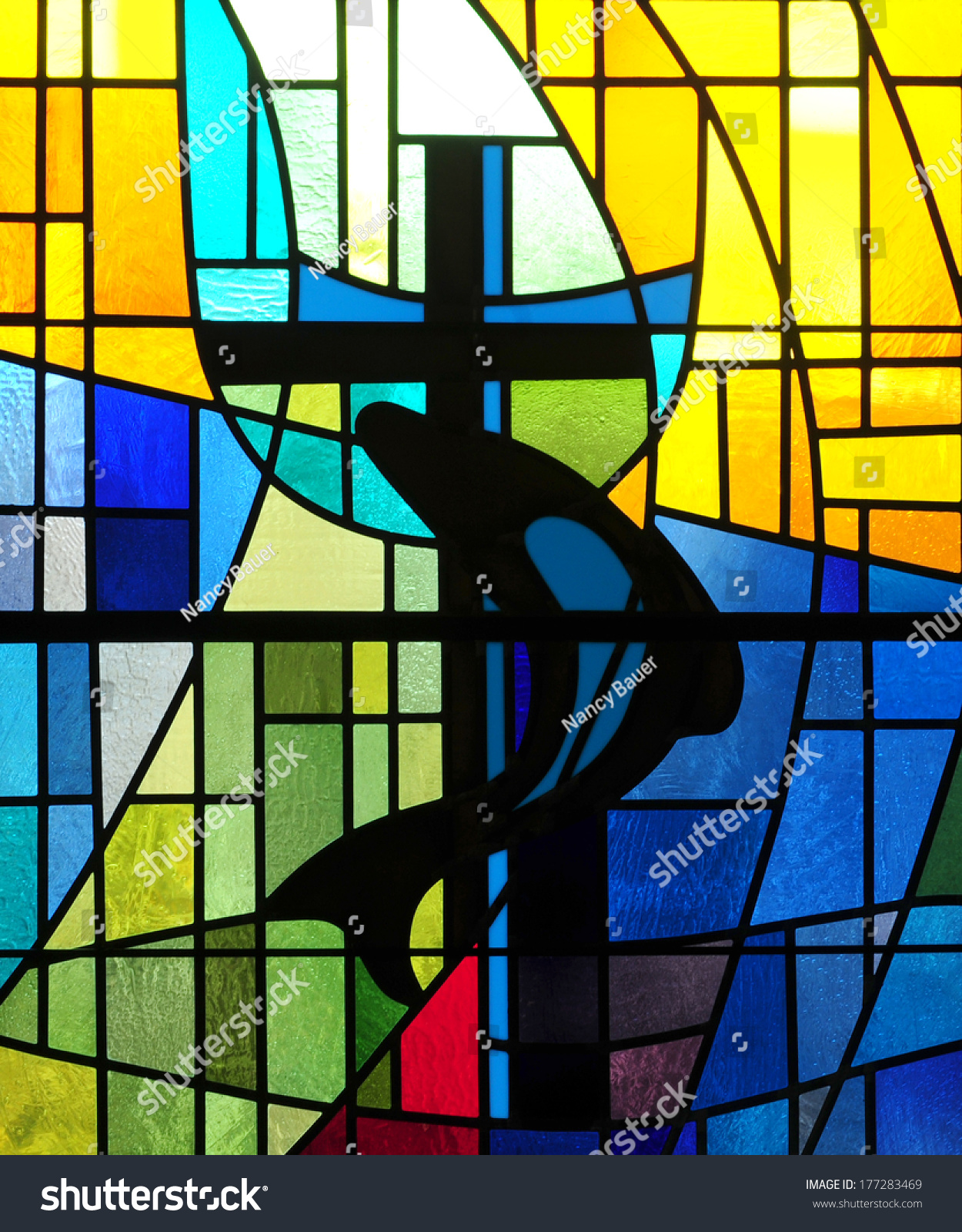 Modern Stained Glass Window Depicting Christian Cross With