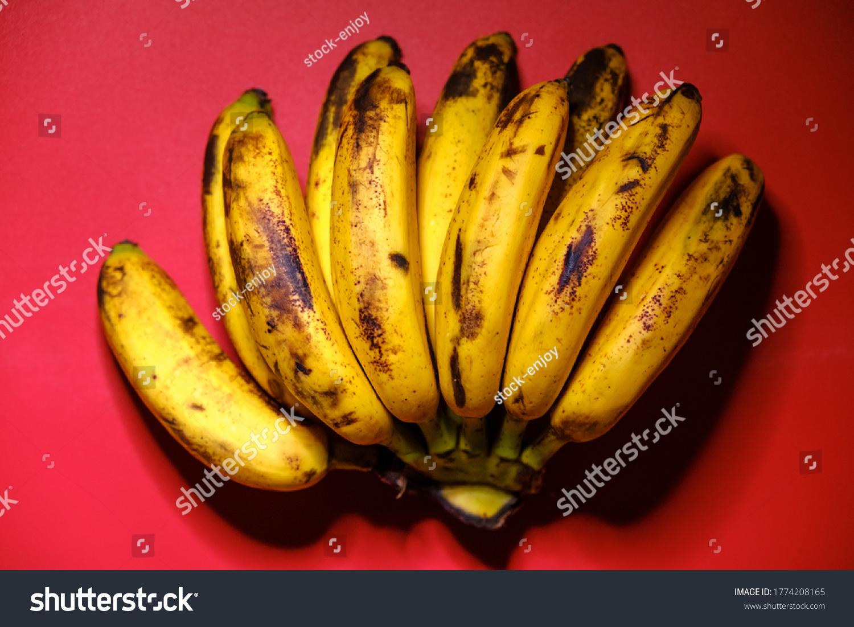 stock-photo-organic-bananas-on-red-backg