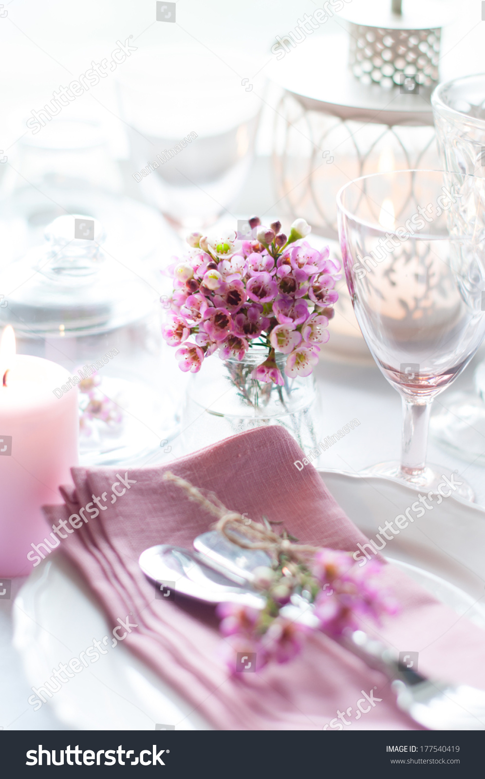 Bouquet of pink flowers on a festively decorated table a bright id 177540419 izmirmasajfo