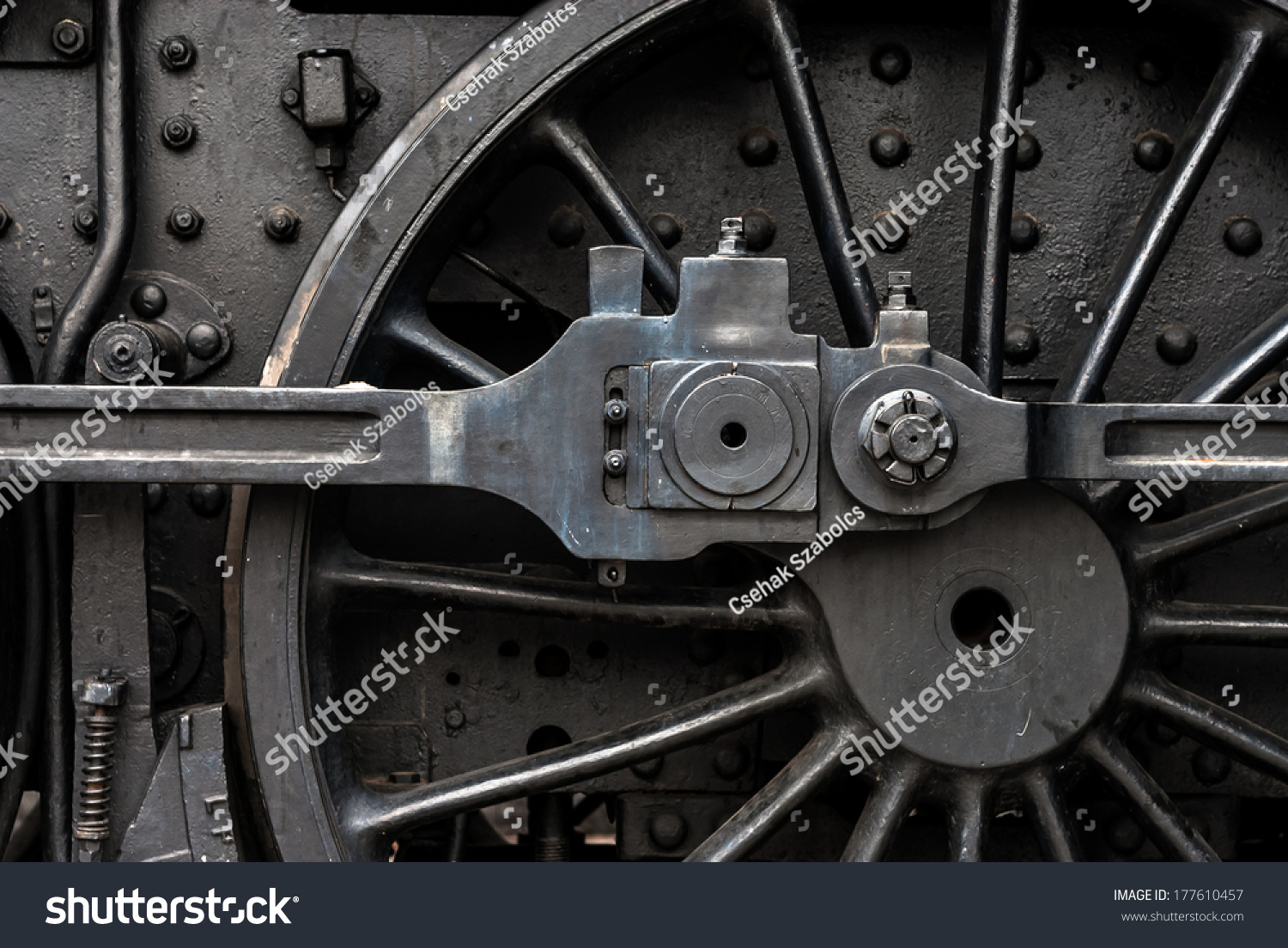 Old Engine Gears : Huge black metal gear train wheel stock photo