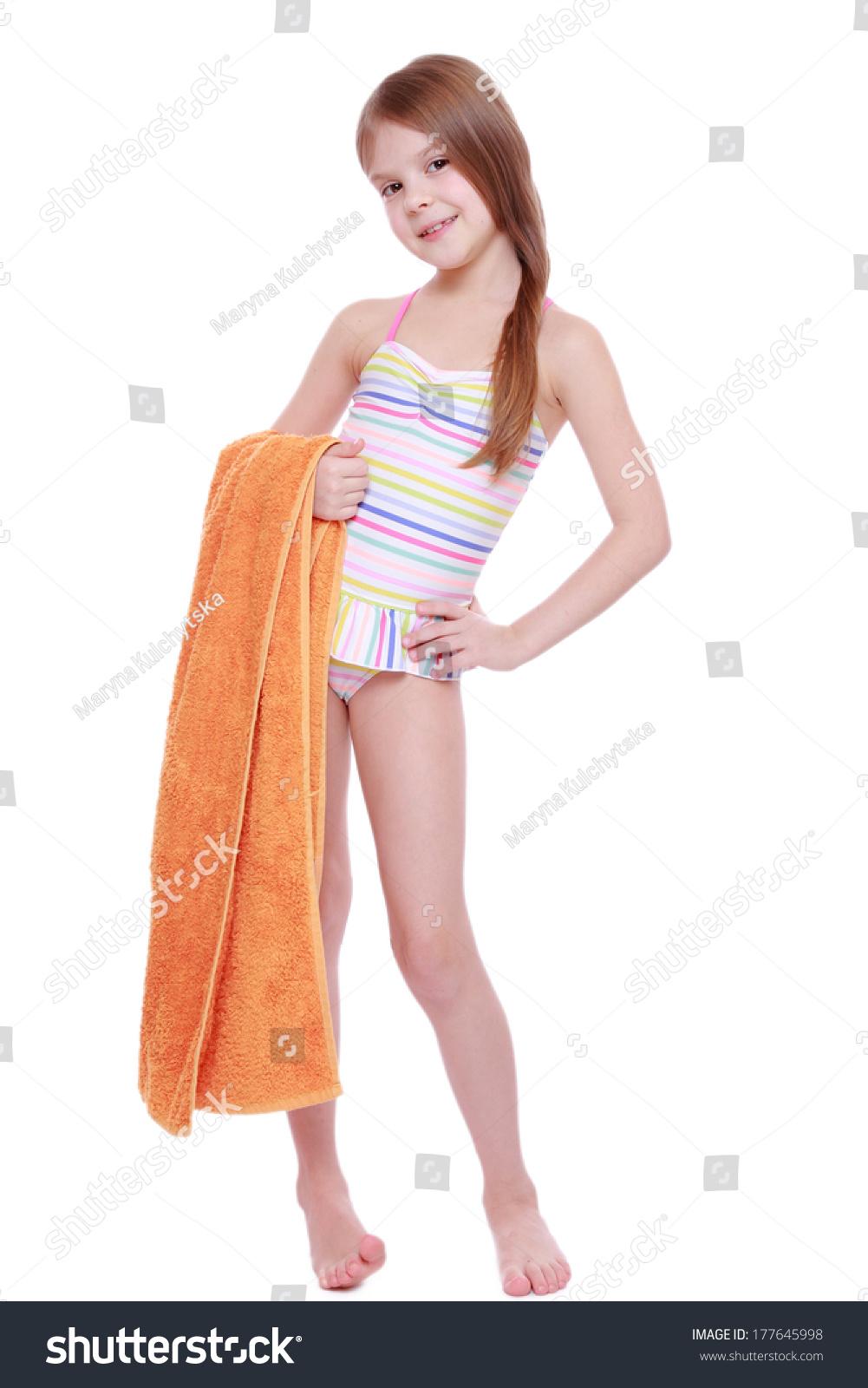 preeteens bikini caucasian little girl in swimsuit holding orange towel - stock photo