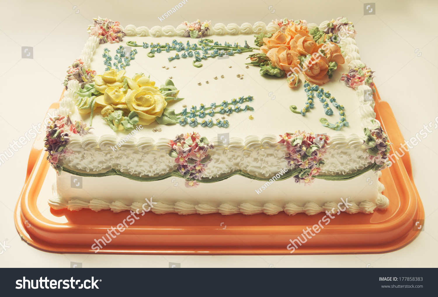 Classical Birthday Cake Design With A Lot Of Flowers Cream