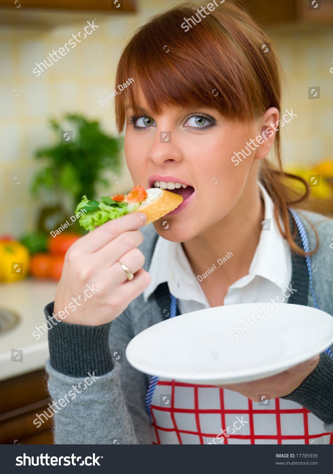 Beautiful Eat In Kitchens: Beautiful Woman Kitchen Eating Sandwich Stock Photo