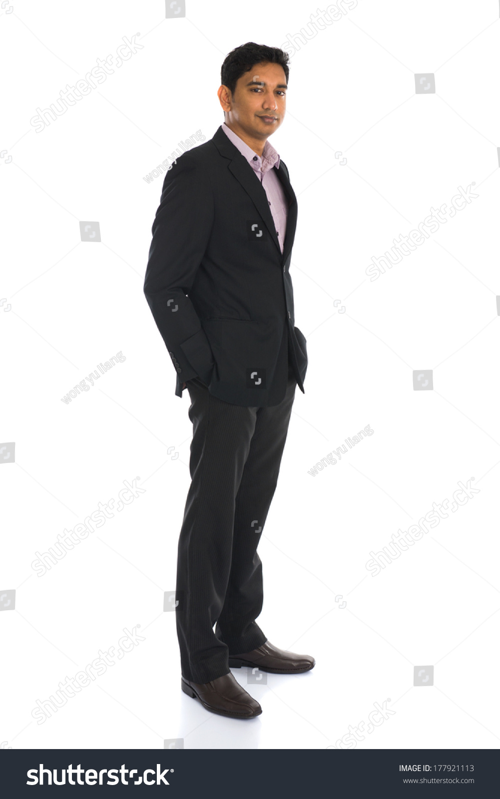 stock-photo-serious-indian-male-business-man-with-isolated-white-background-full-body-177921113.jpg
