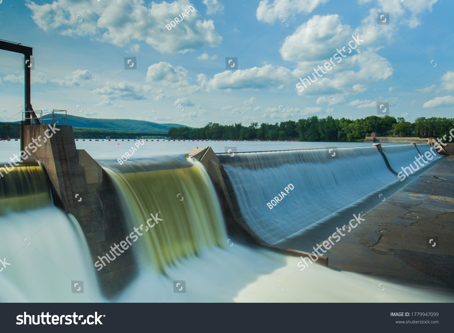Hydroelectric power energy plant with turbines and water spills for generating green electricity. Free, green adn ecological energy concept. Climate changes #1779947099