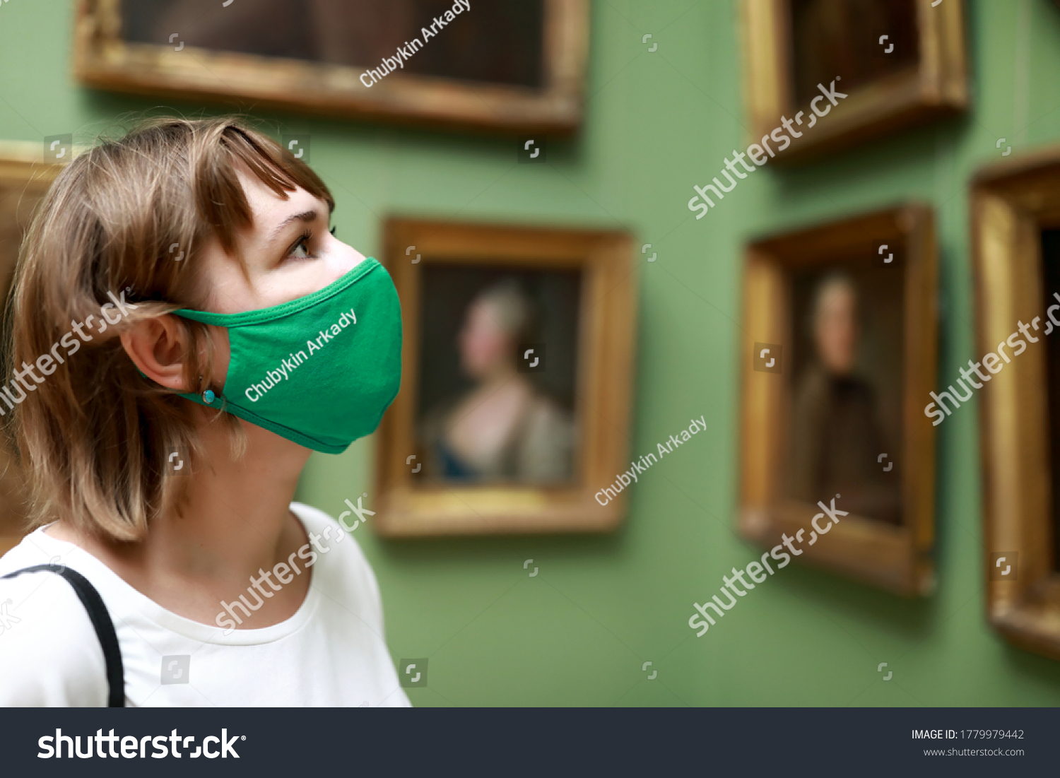 Portrait of woman wearing protection mask in museum #1779979442