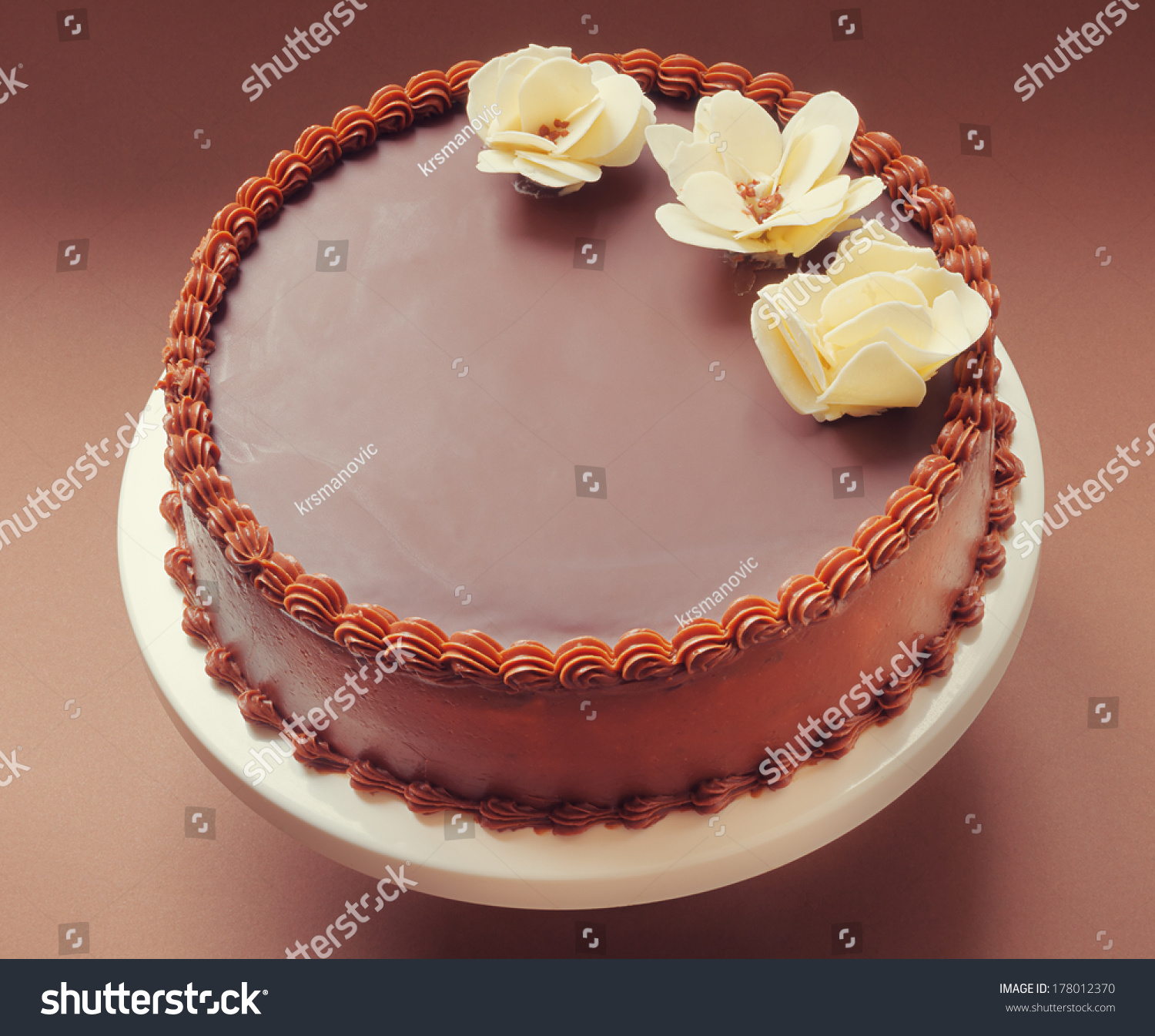 All chocolate birthday cake on brown stock photo edit now all chocolate birthday cake on brown background decorated with yellow flowers on top izmirmasajfo