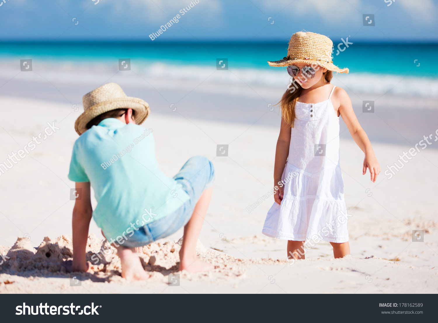 Brother Sister Beach Enjoying Vacation Stock Photo