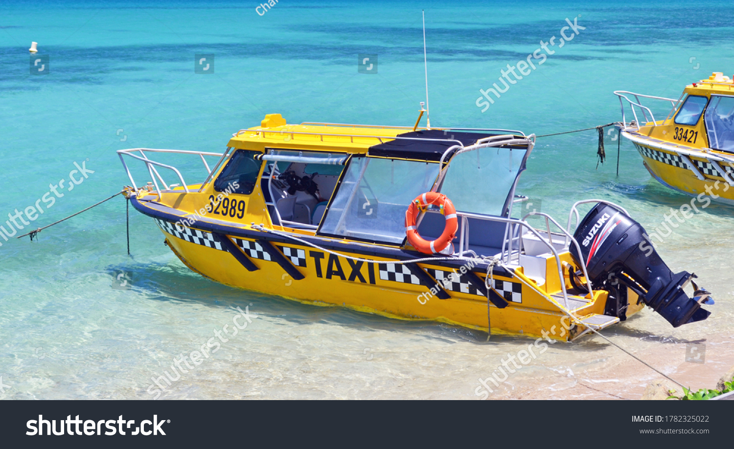 Noumea, New Caledonia/France - February 13 2012: water taxis await their customers at the beach in Noumea.