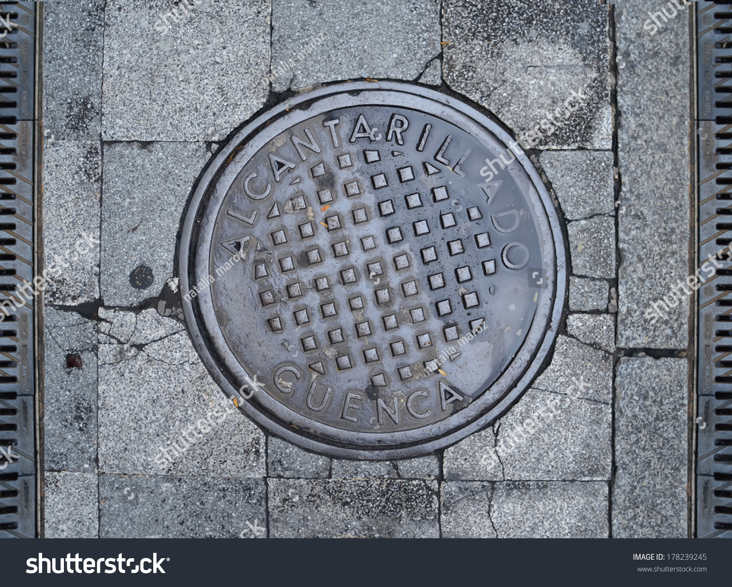 Metal Sewer Hatch On Stone Block Stock Photo (Edit Now