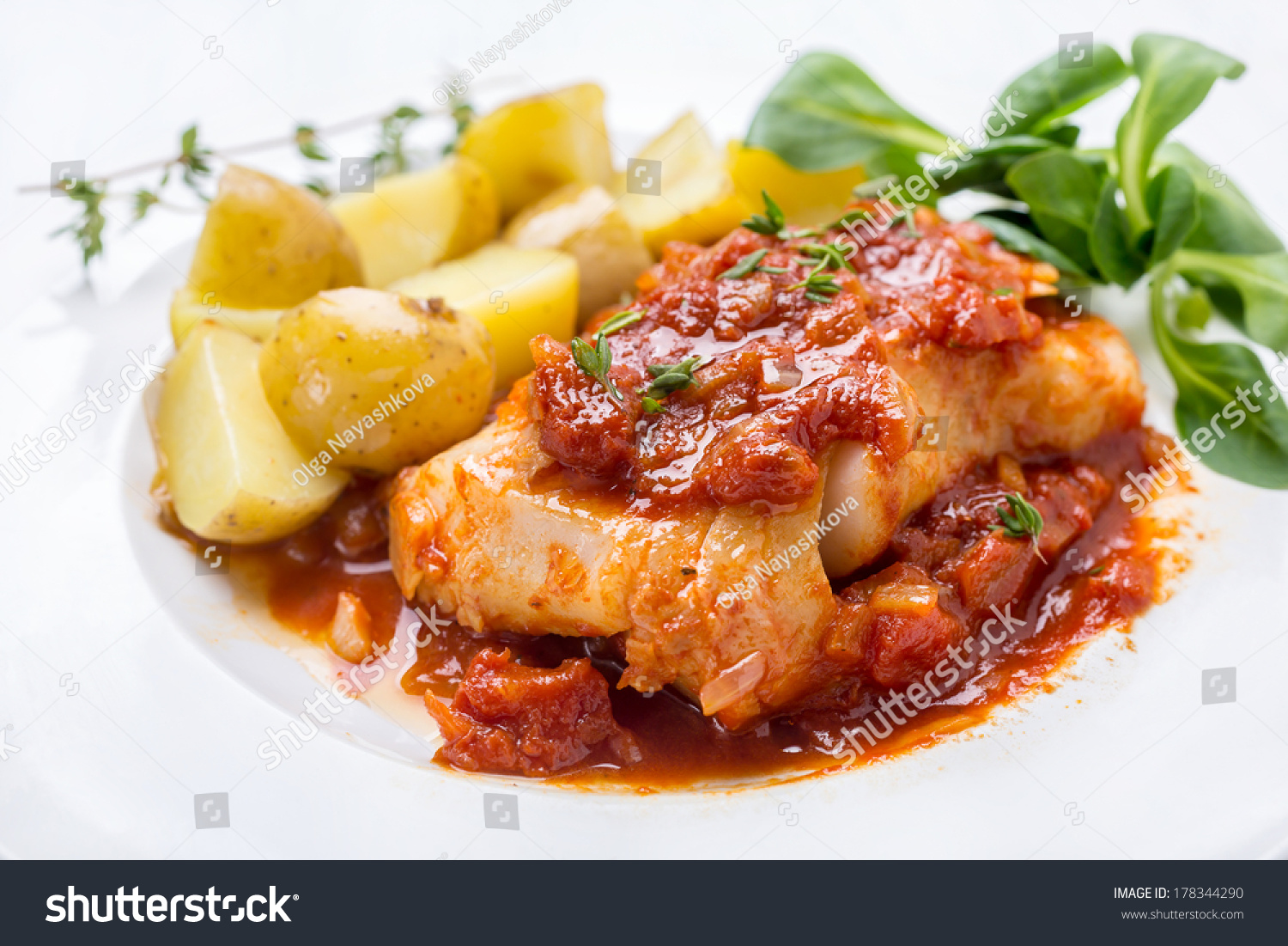 Plate of Cod or Pollack Fish Fillet Stewed in Tomato and Thyme Sauce ...