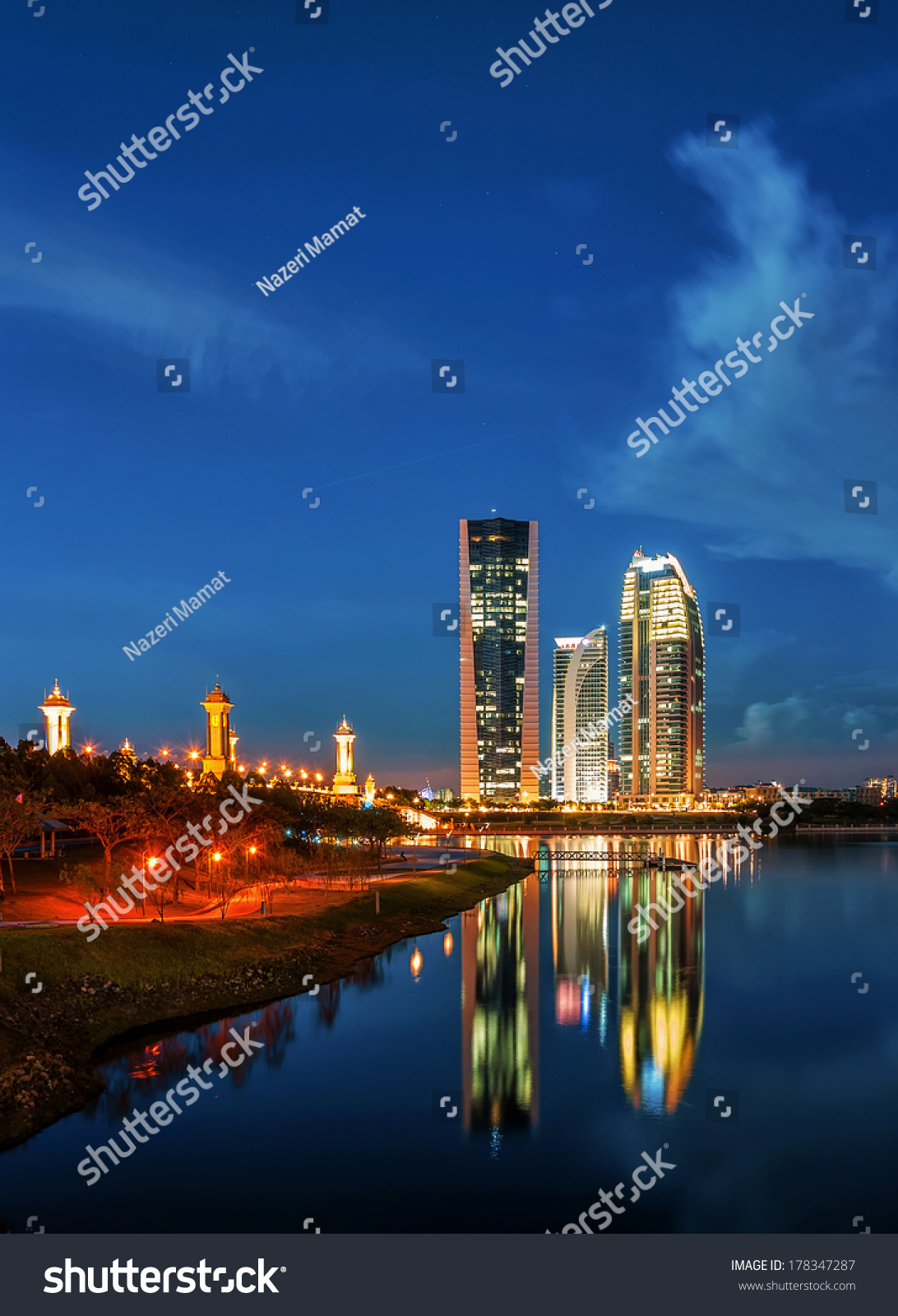 Modern office buildings by Putrajaya Lake Malaysia at sunset