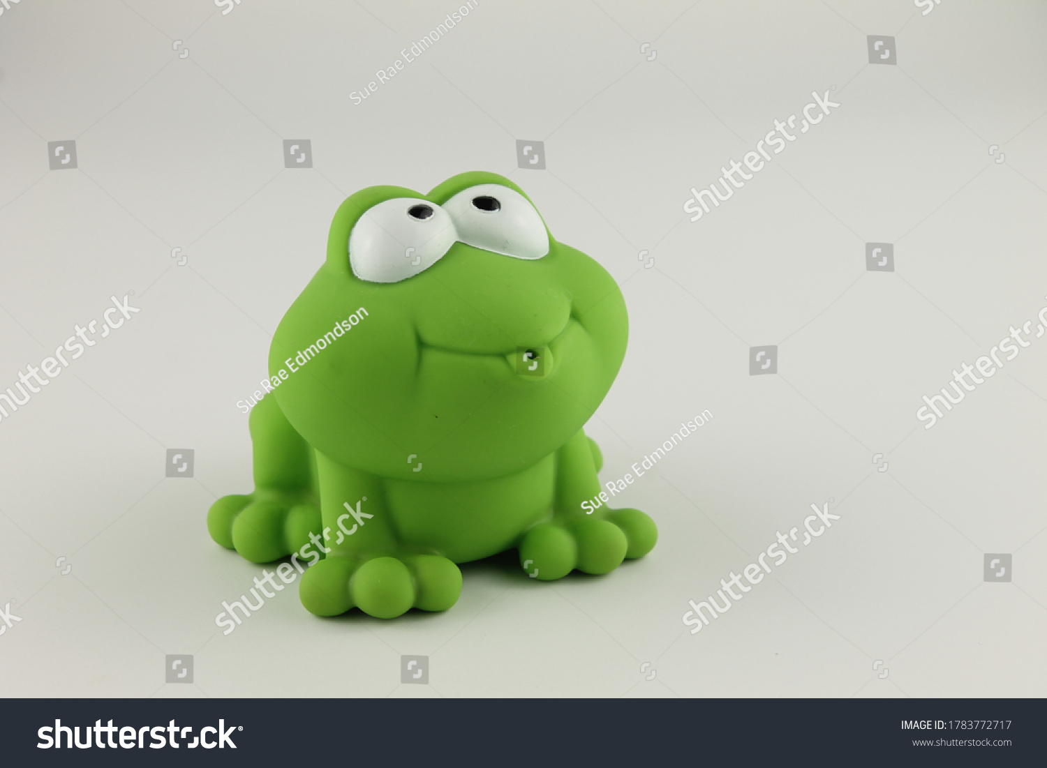 stock-photo-green-rubber-toy-frog-isolat