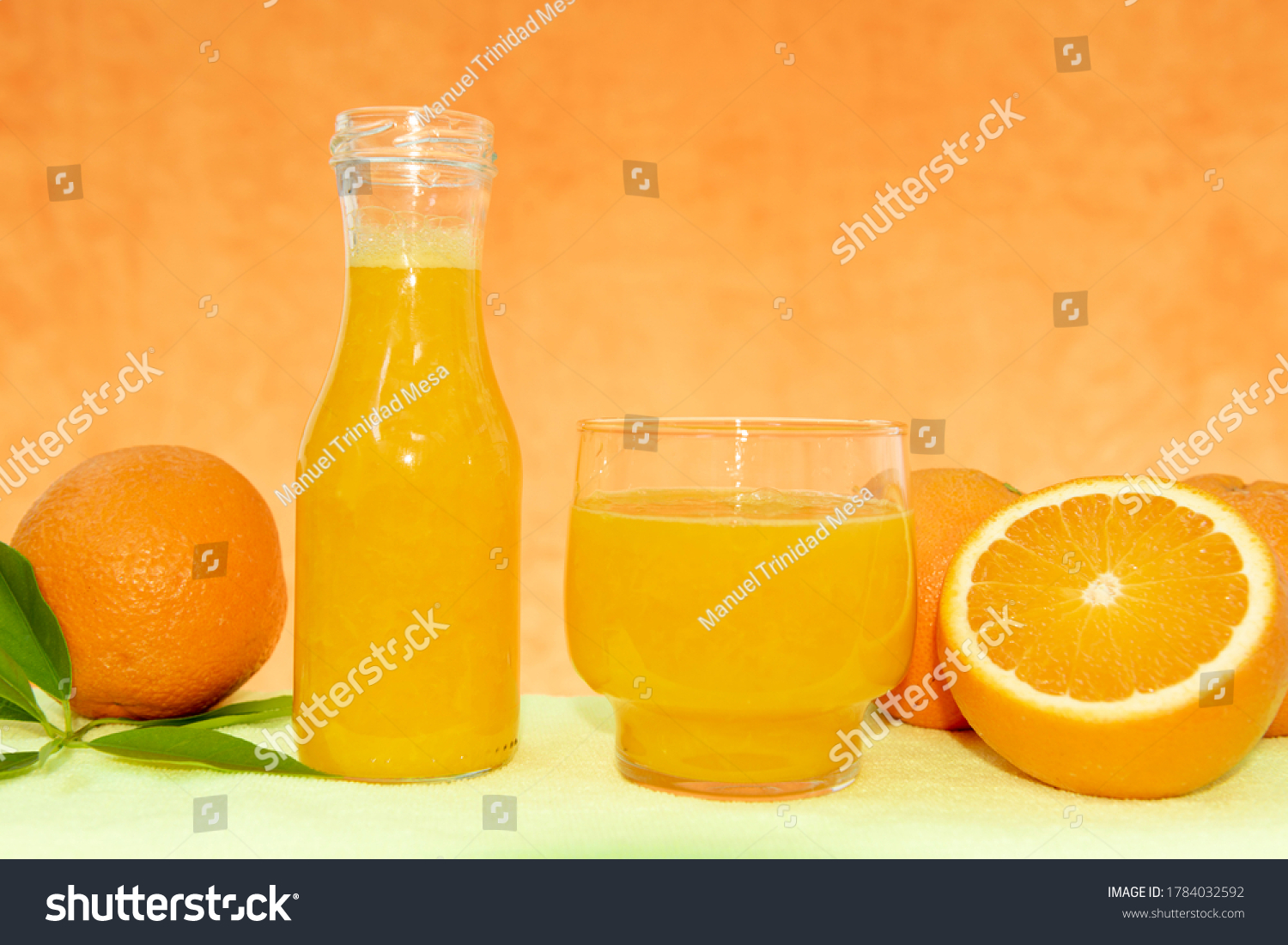 stock-photo-glass-bottle-with-fresh-oran