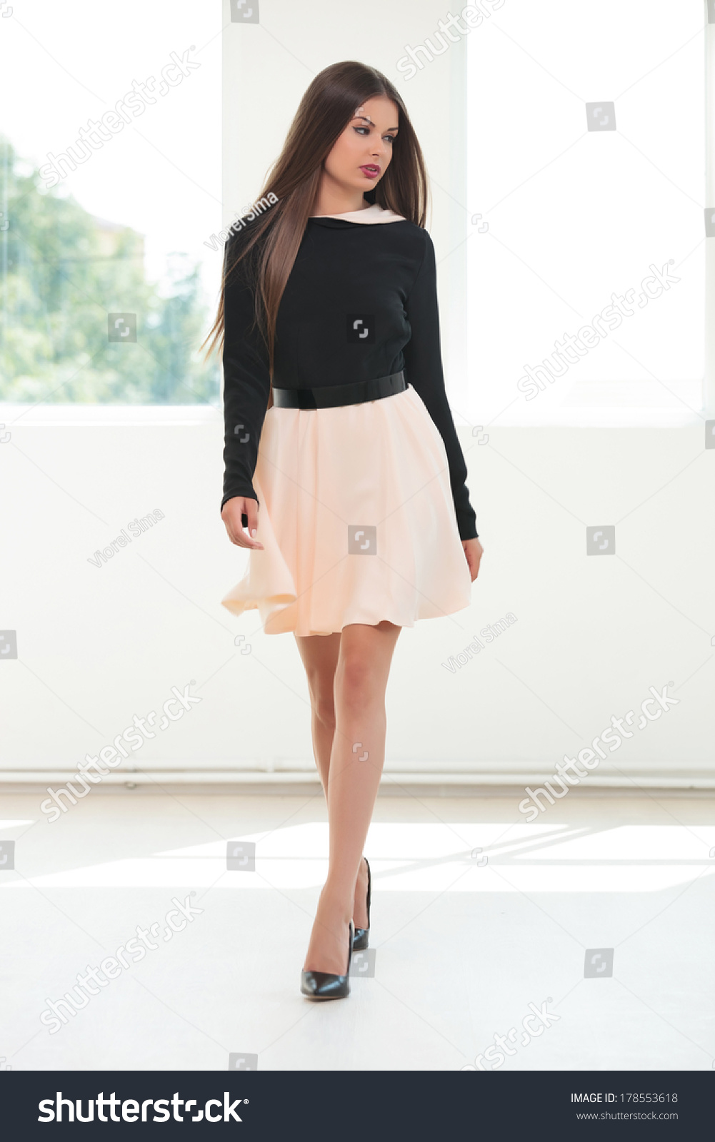 Full Length Portrait Of A Young Fashion Woman Walking ...