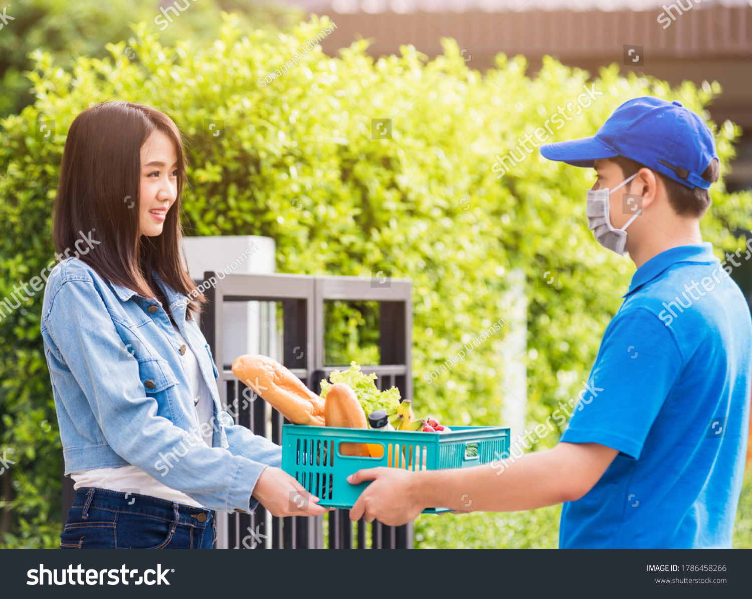 stock-photo-asian-young-delivery-man-wea