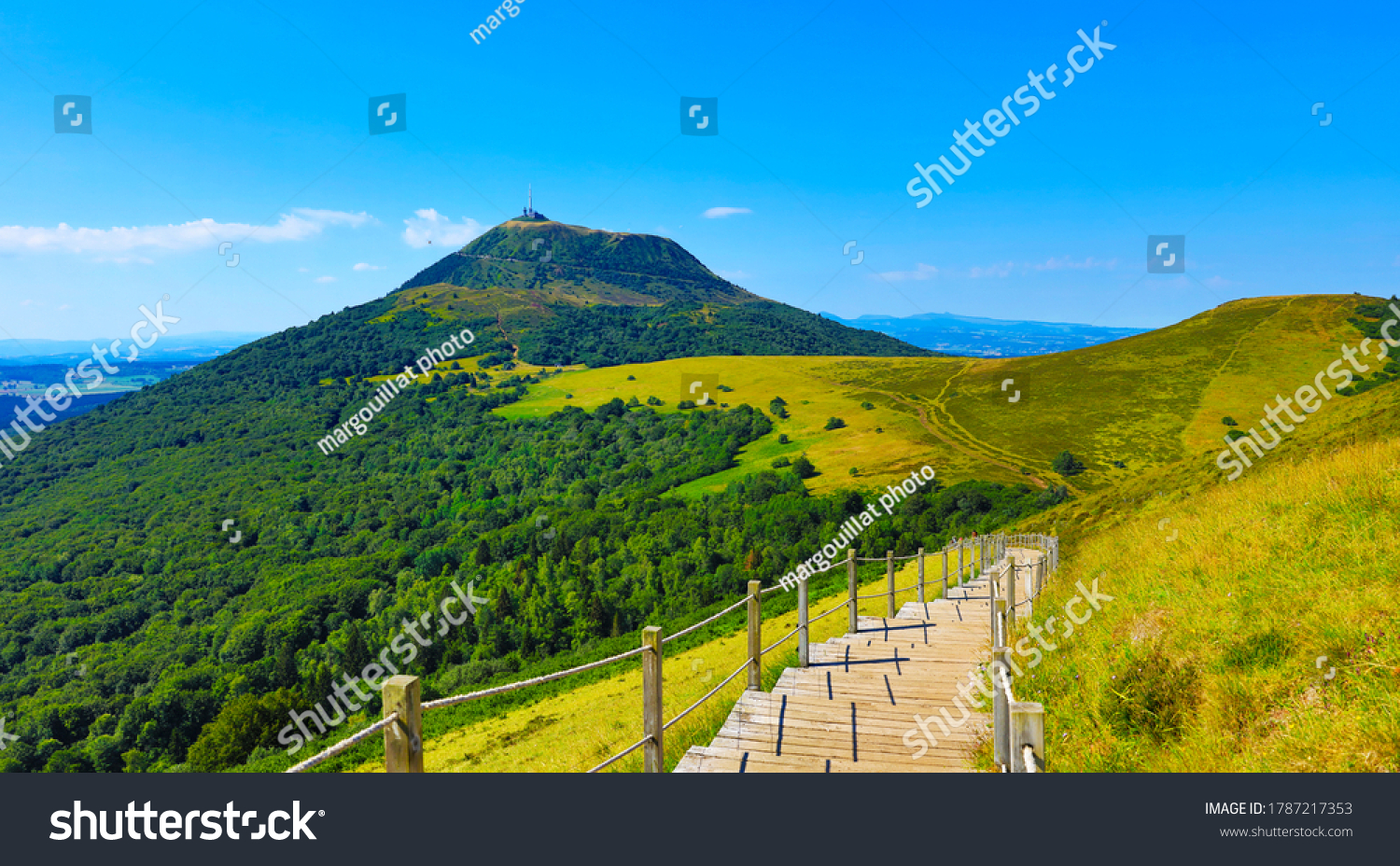 Puy de Dome- Auvergne in France- Volcanic landscape and blue sky #1787217353