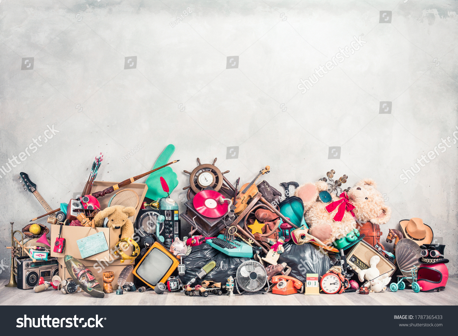 Old antiques and retro collectibles memorabilia dumped in a huge pile. Garage sale, attic room storage conceptual still life or disposal and recycling of outdated objects. Vintage style filtered photo #1787365433