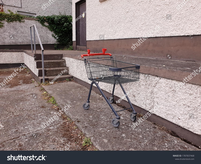 stock-photo-empty-shopping-trolley-aband