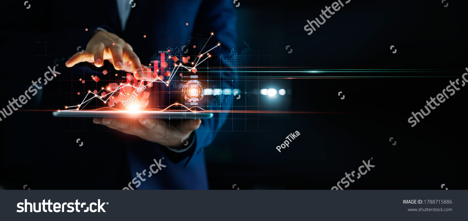 Businessman using tablet analyzing sales data and economic growth graph chart and block chain technology on global network on dark background. #1788715886