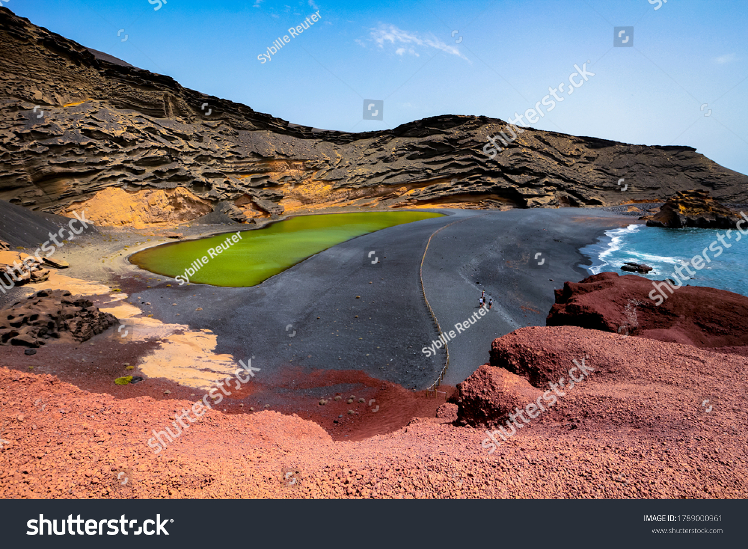 """Lago Verde (""""Green Lake"""") or Charco de Los Clicos in El Golfo, Lanzarote, Canary Islands, Spain. Uniquely colorful landscape with black sand beach, dark volcanic rocks and red earth.  #1789000961"""