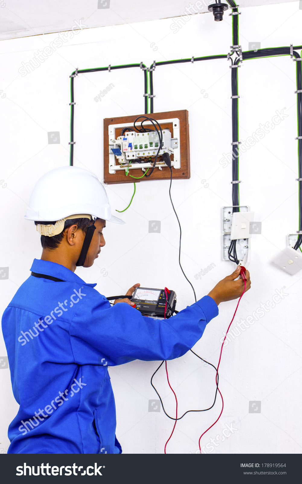 wire man during testing at surface wiring