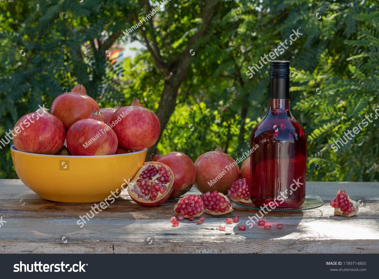 stock-photo-a-bottle-with-pomegranate-li