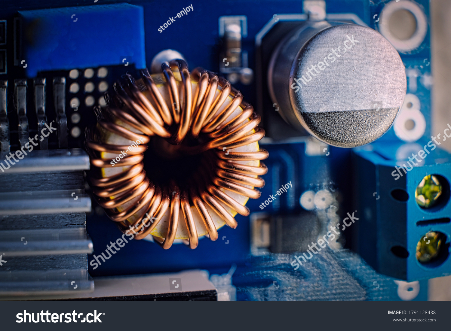stock-photo-ferrit-inductance-coil-on-el