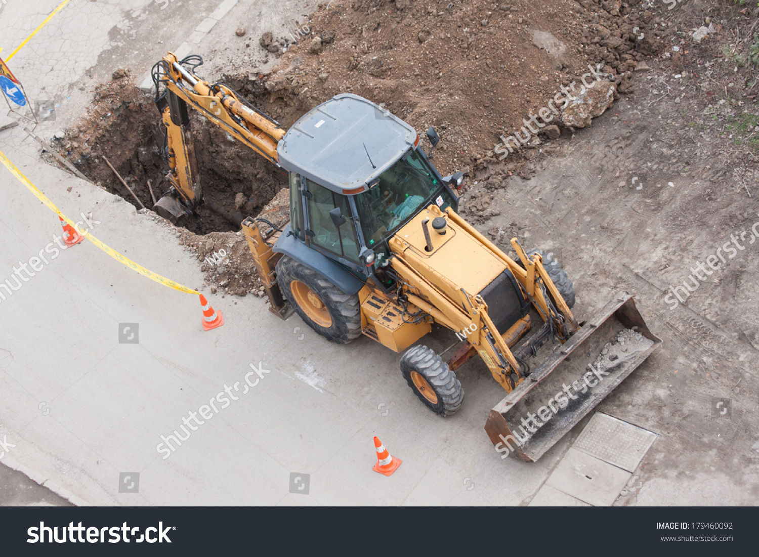Tractor Water Pipe : Tractor excavator digging the ground to stop leaking
