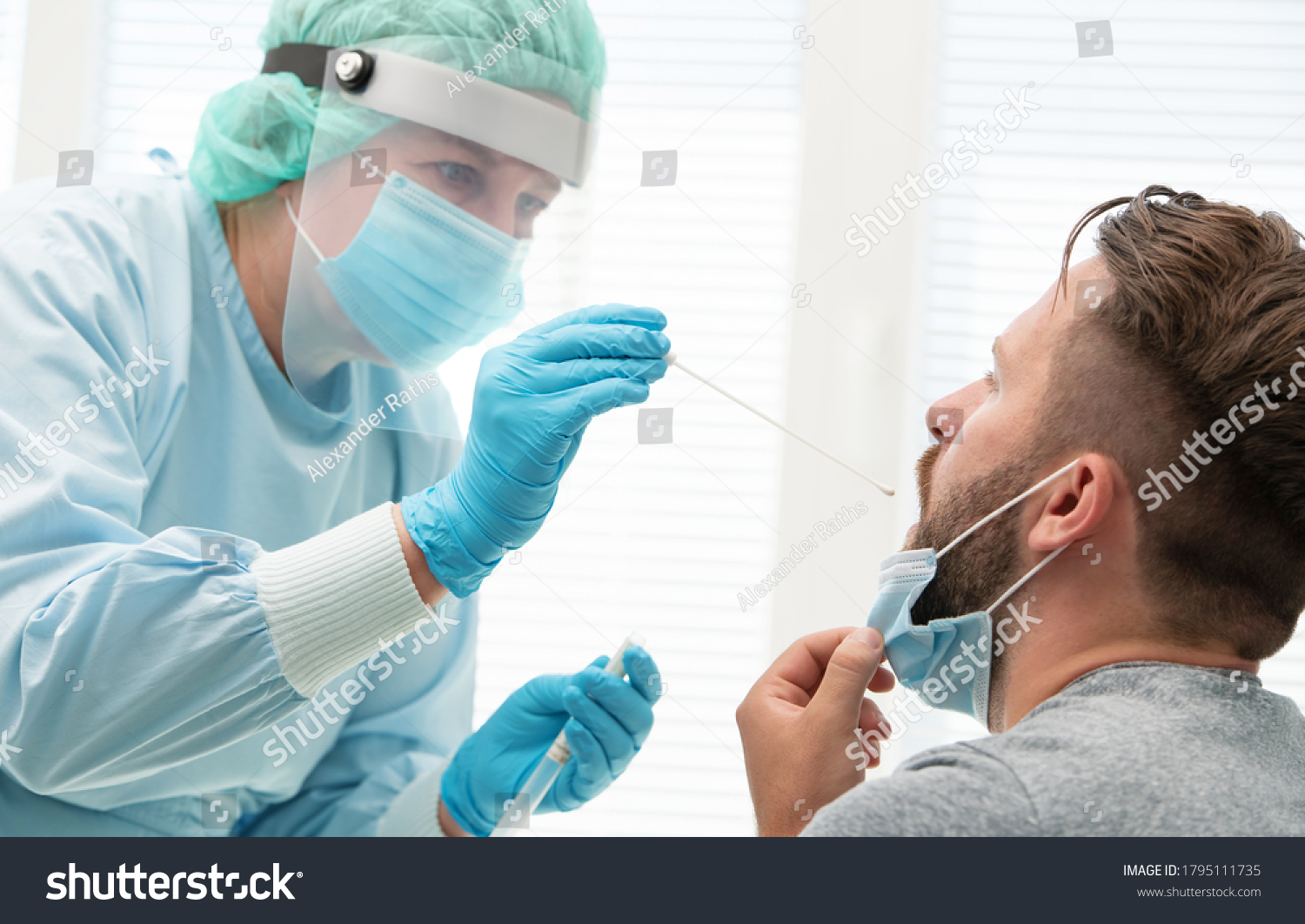Doctor in a protective suit taking a throat and nasal swab from a patient to test for possible coronavirus infection #1795111735