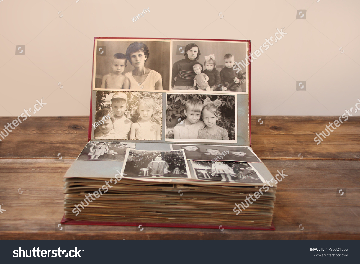 old retro album with vintage monochrome photographs in sepia color, taken in 1955-1960, concept of genealogy, the memory of ancestors, family ties, childhood memories #1795321666