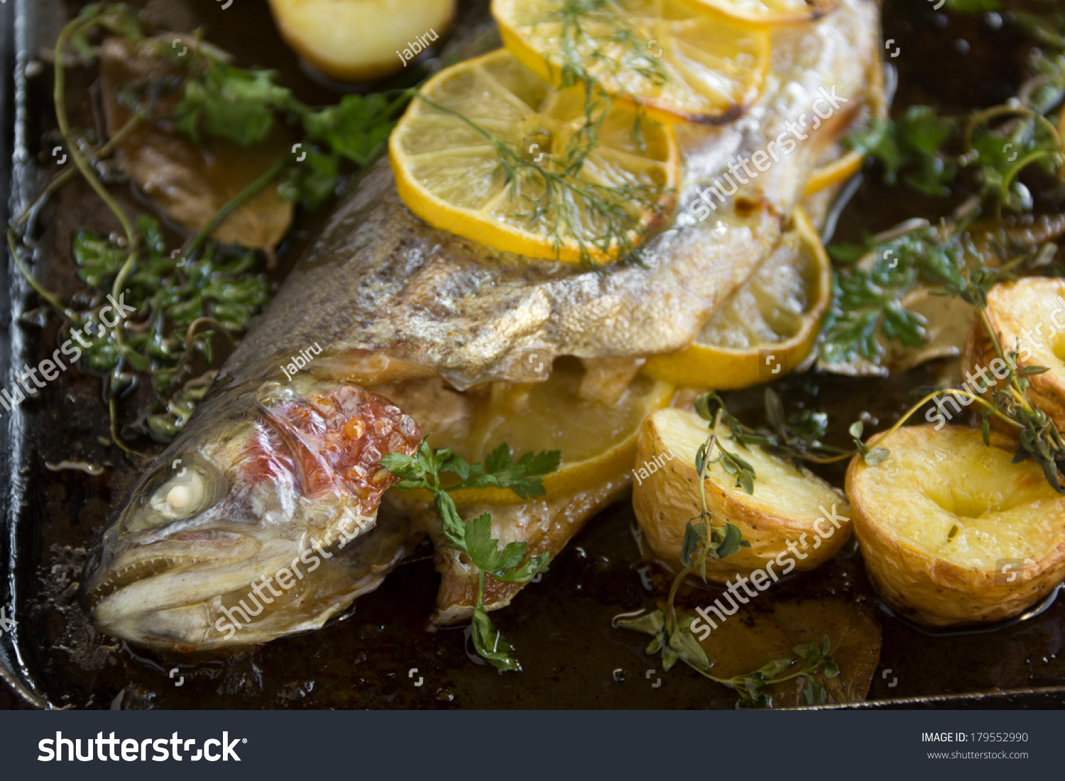 Delicious baked rainbow trout straight from the oven with potato ...