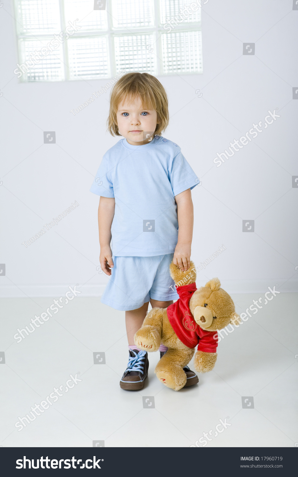 young sad girl standing holding teddy stock photo 17960719