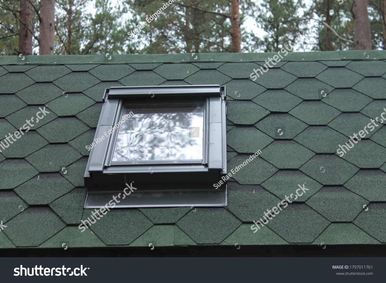 Shingles roof top with sky light window
