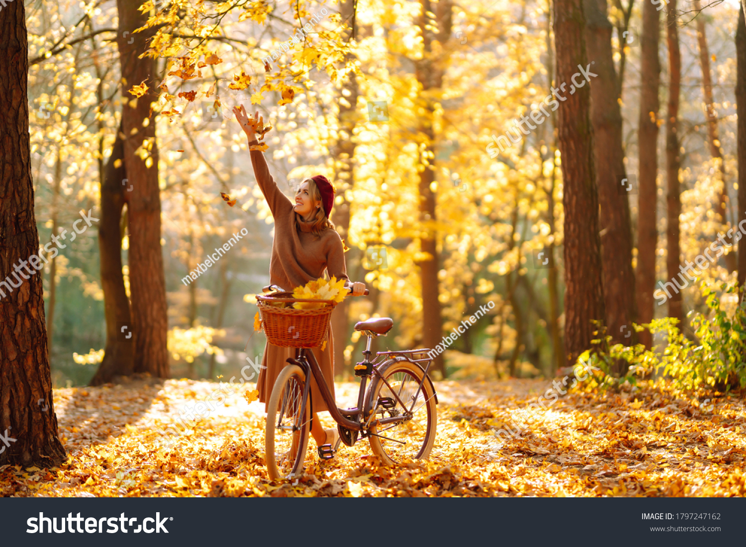 Beautiful Woman throws up autumn leaves and having fun  in autumn park. Relaxation, enjoying, solitude with nature. #1797247162
