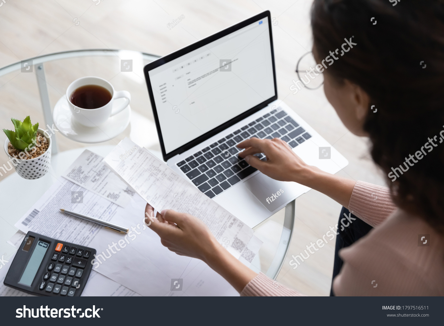 Close up top view of concentrated woman work on laptop manage family expenditures expenses using gadget, focused housewife busy calculating finances, plan budget on computer, pay bills or taxes online #1797516511