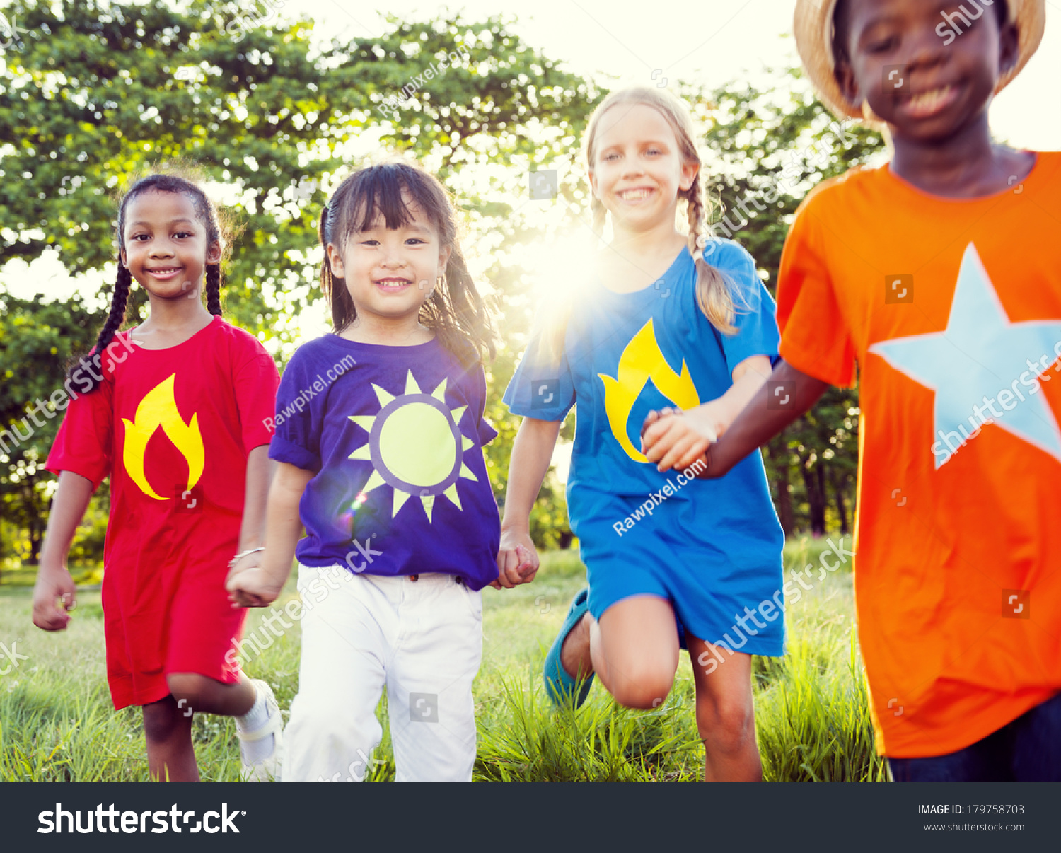 Friendship: Diverse Children Playing Super Heroes In Park Stock Photo ...