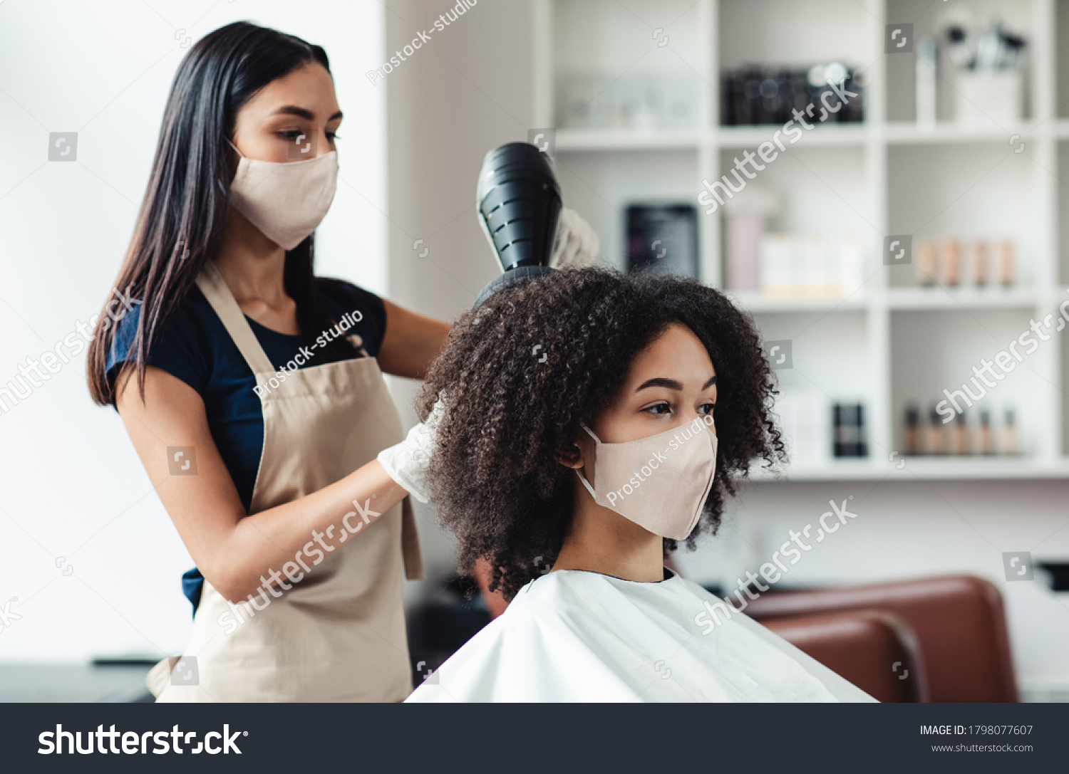 Be safe and beautiful. Hairdresser and customer wearing protective masks at beauty salon, close up #1798077607