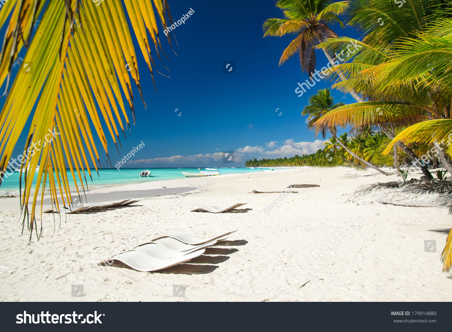 Caribbean beach with chaise longues stock photo 179914880 for Beach chaise longue