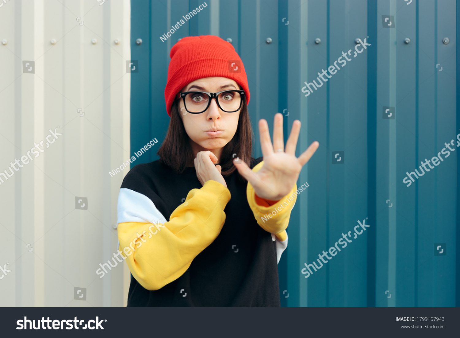 Unhappy Young Woman Making Stop Gesture with Hand. Assertive girl expressing disapproval and rejection  #1799157943