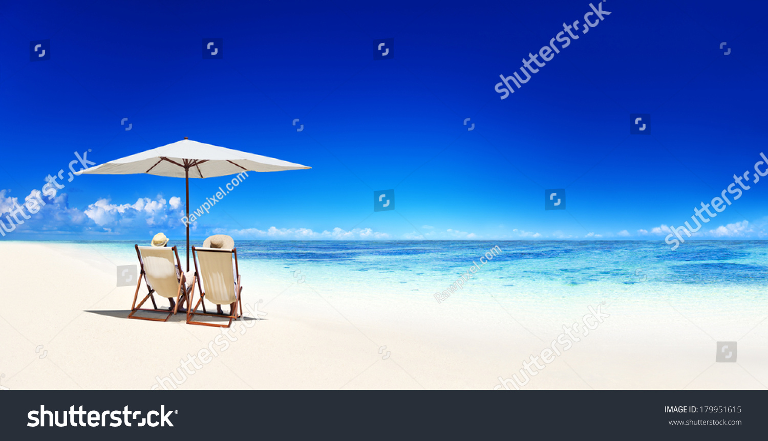Couple Relaxing in Deck Chairs on Tropical Beach #179951615