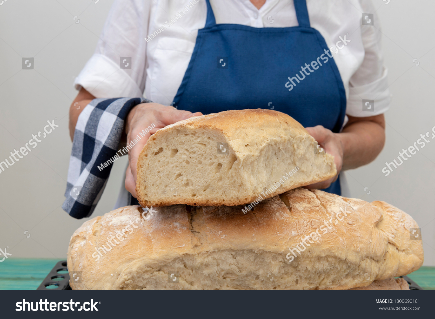 Female baker shows freshly baked bread