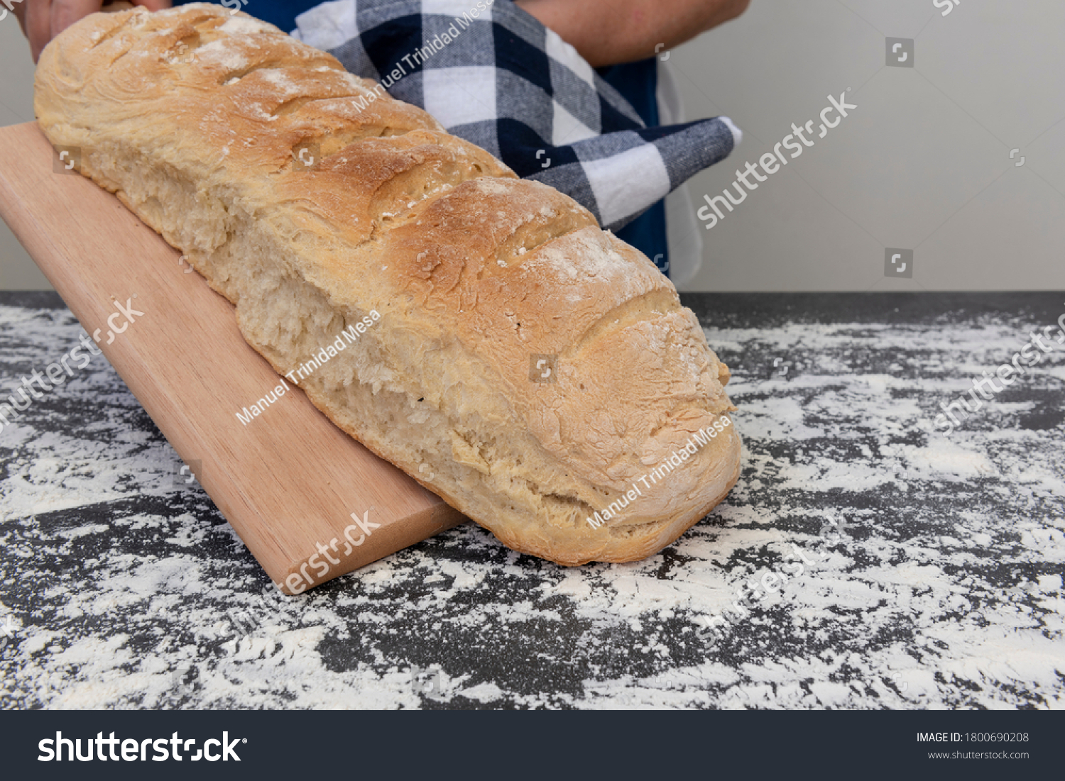 Person places hot bread from oven on table
